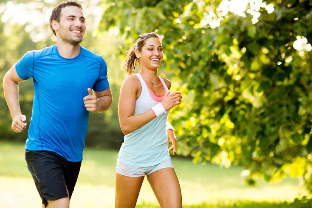 Young happy couple running - How to Start Running As a Beginner