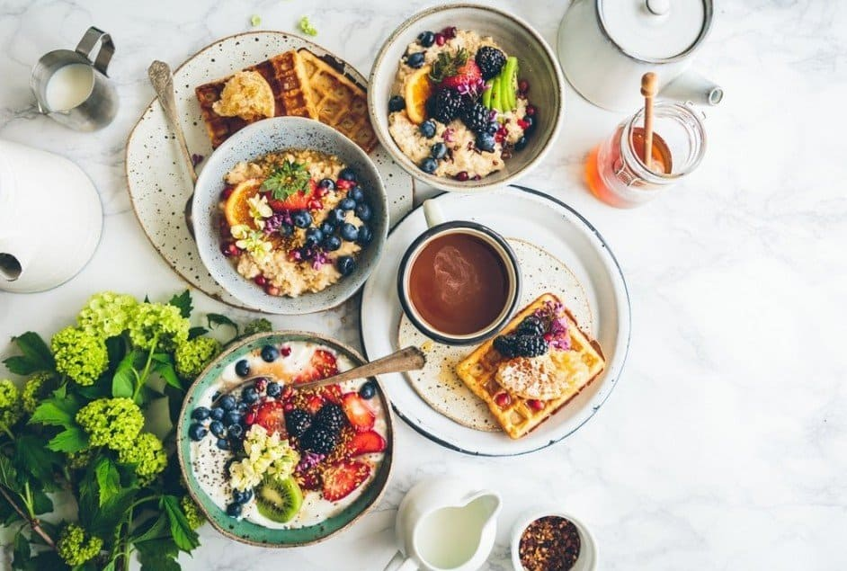 Breakfast with high-fiber grain with a handful of fruit, or a cup of oatmeal with some milk and also berries.