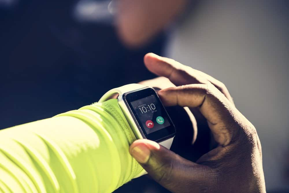 Closeup of smartwatch on a wrist - Closeup of mockup smartwatch isolated on whtie background - people, bedtime and rest concept - Benefits in Wearable Technology