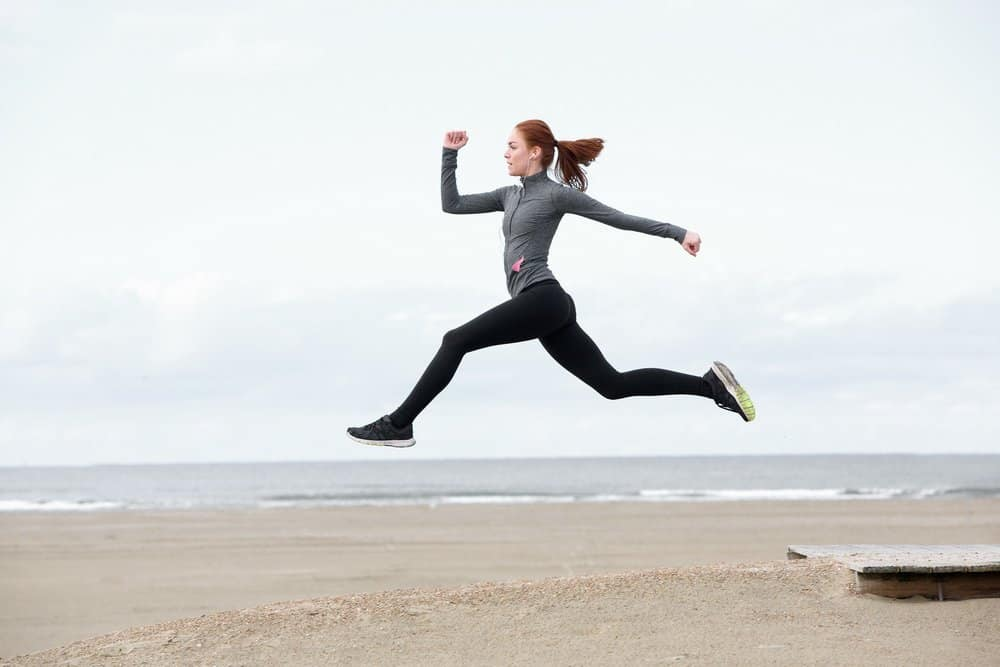 Fit young woman running and jumping - Is Mediterranean diet the healthiest in the world?