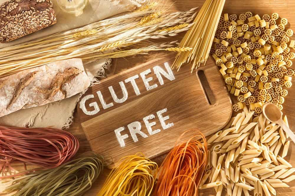 Gluten free food. Various pasta on wooden background from top view. Healthy and diet concept. - The Metabolic Reset Diet Plan