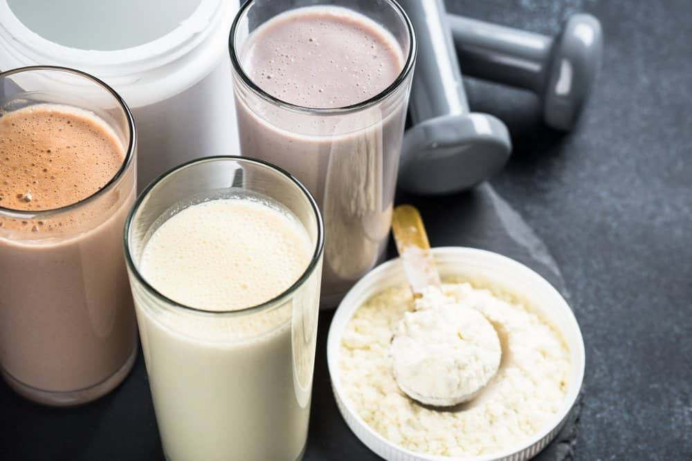 Protein cocktails on black. Vanilla, berry and chocolate protein shakes. Sports nutrition. - Diet Smoothies for Weight Loss