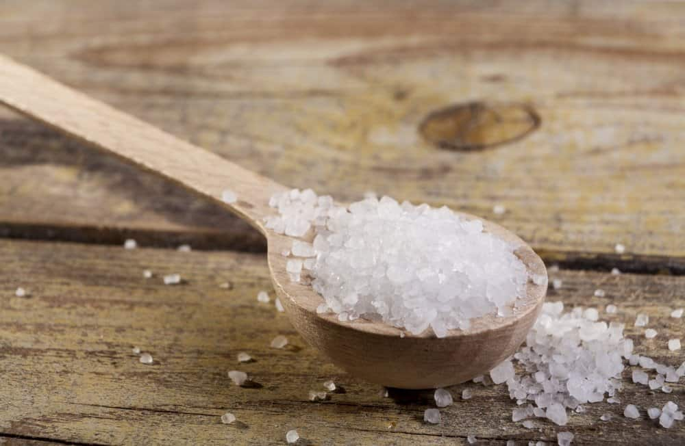 Old Brown wood spoon with salt cristals on wood table - A Natural Way to Detox Your Body