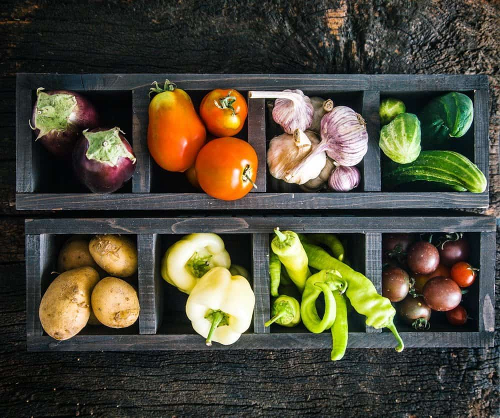 Vegetables on wood. Organic vegetables in rustic setting. Fresh food. Healthy veggies - Fatty fish - Is Mediterranean diet the healthiest in the world?