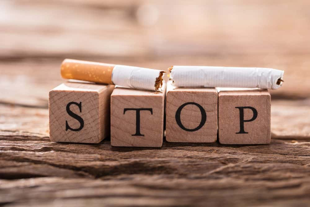 A Cigarette And Wooden Blocks Showing Stop Word On Desk - 10 Ways to Lose Belly Fat