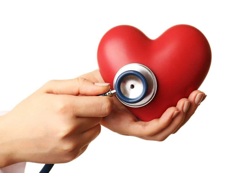 Doctor hands with heart and stethoscope - Signs You're Overdoing Cardio