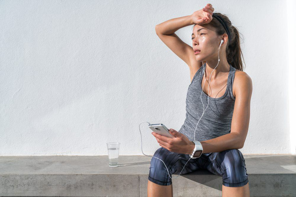 Exhausted Asian runner dehydrated feeling exhaustion and dehydration from working out at gym - 10 Reasons why Water is Important