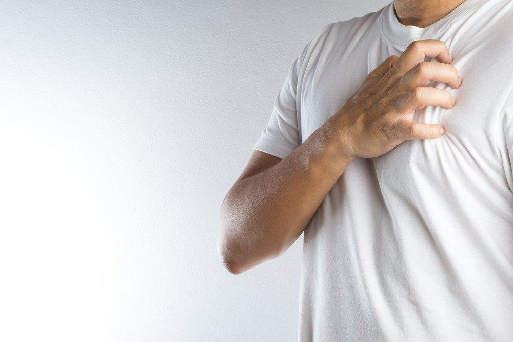 Man with chest pain - Signs You're Overdoing Cardio