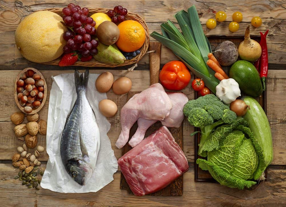 Various Paleo diet products on wooden table - The Paleo Diet Explained