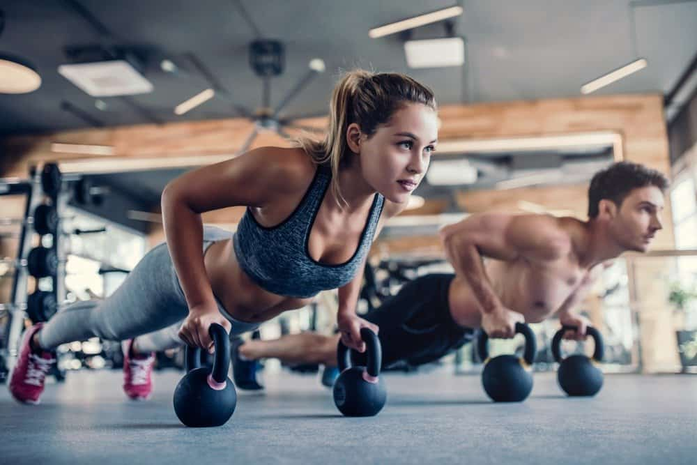 Young couple is working out at gym - Habits of Super Healthy People