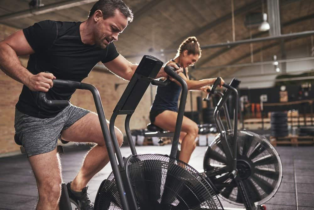 Young man and woman wearing training - Signs You're Overdoing Cardio