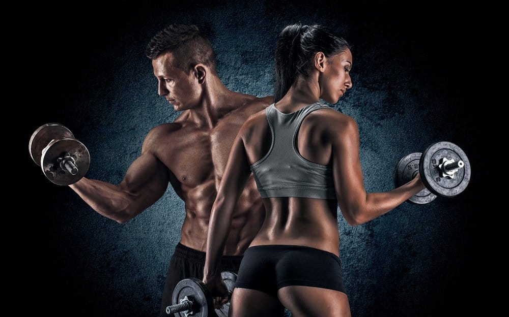 Man and woman lifting dumbells - Best Strength Training Workout