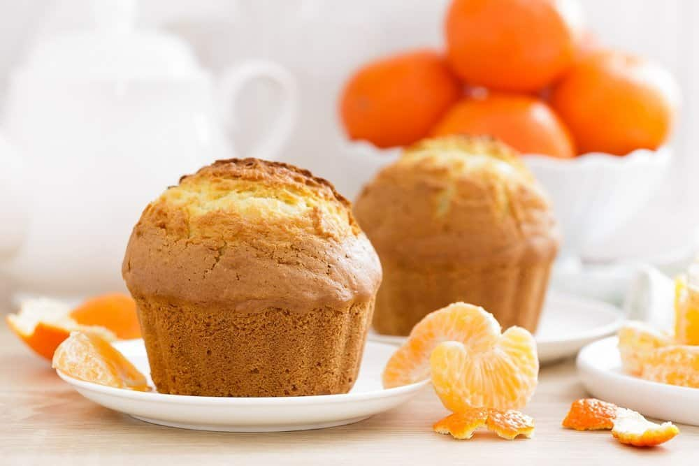 Muffin with tangerines closeup on white background. Sweet delicious homemade baking. . White background. Wooden background. - Top 10 Ways to Weight Loss