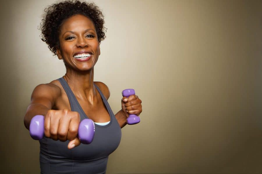 relaxed woman lifting weights - HIIT vs LIIT