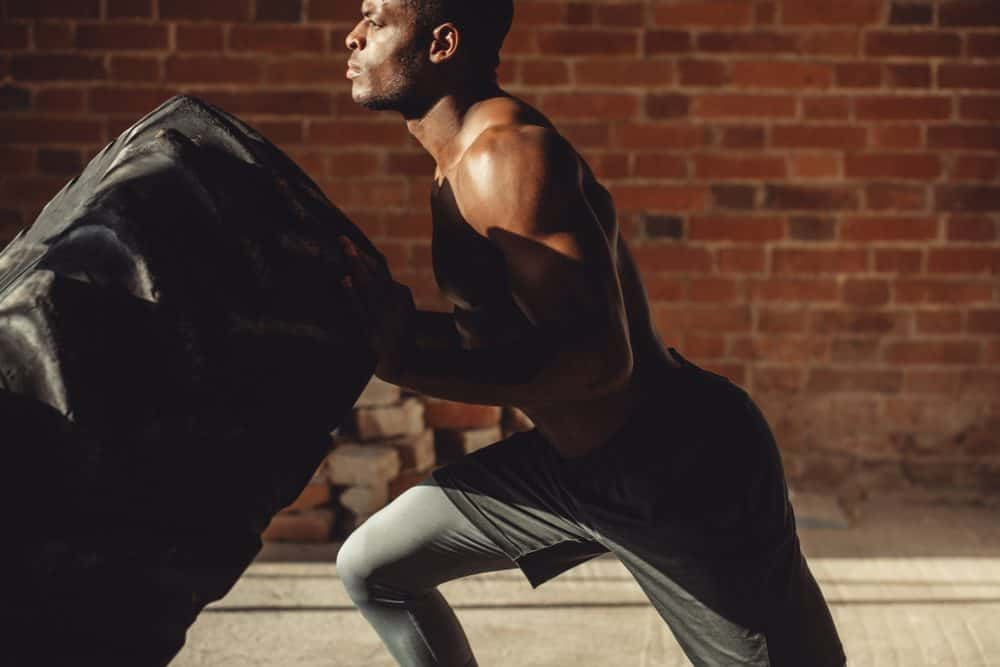 training with the help of a crossfit tire - HIIT vs LIIT