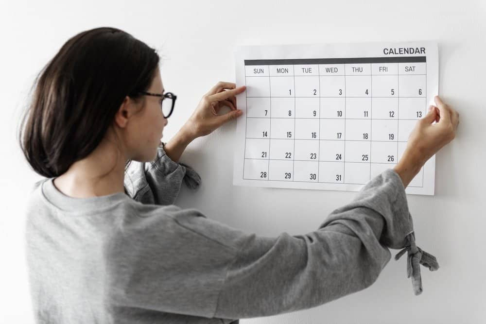Woman checking the calendar - Top 10 Ways to Weight Loss