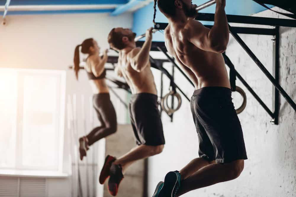 Adults doing cross fit training in the gym - How Frequently Should a Beginner Exercise Running to Achieve Best Results for the Body and Avoid Injuries Explained