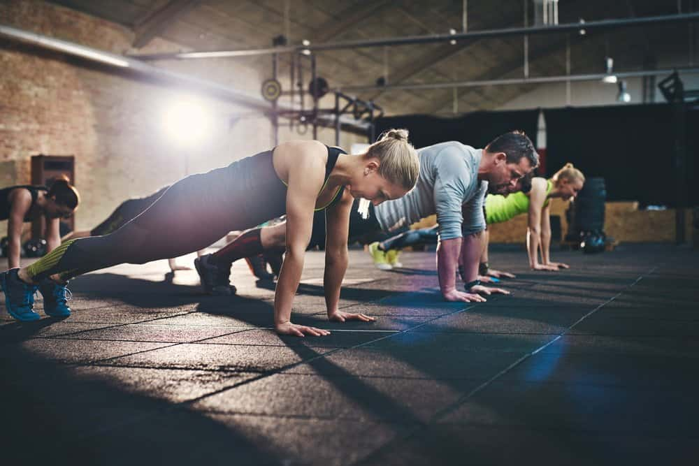 Adults doing push ups as part of Coss-Training Workout - How to Boost Your Body's Fitness Level and Avoid The Risk of Injury. The Ultimate Guide in Cross-Training.