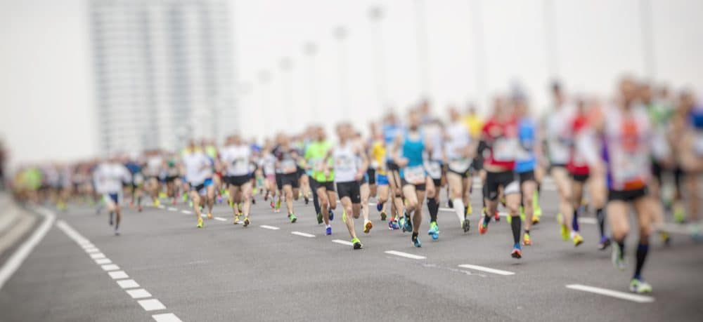 Blur marathon runners in the city - How Frequently Should a Beginner Exercise Running to Achieve Best Results for the Body and Avoid Injuries Explained
