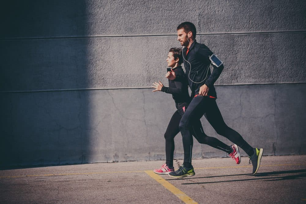 Couple running in an urban area - How Frequently Should a Beginner Exercise Running to Achieve Best Results for the Body and Avoid Injuries Explained