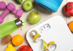 Healthy Lifestyle concept - Healthy food, sport equipment on wooden background. Weight loss - Ideal Body Weight (IBW) Calculator