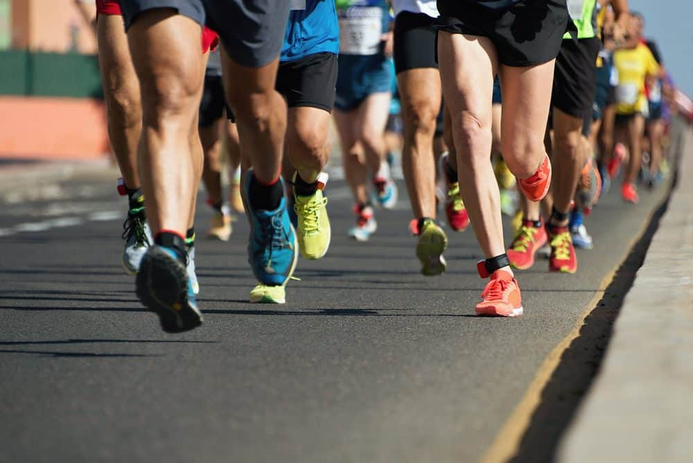 Marathon running on city road - How Frequently Should a Beginner Exercise Running to Achieve Best Results for the Body and Avoid Injuries Explained