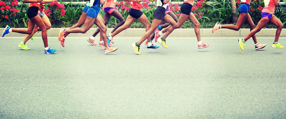 Marathon running race on city road - How Frequently Should a Beginner Exercise Running to Achieve Best Results for the Body and Avoid Injuries Explained