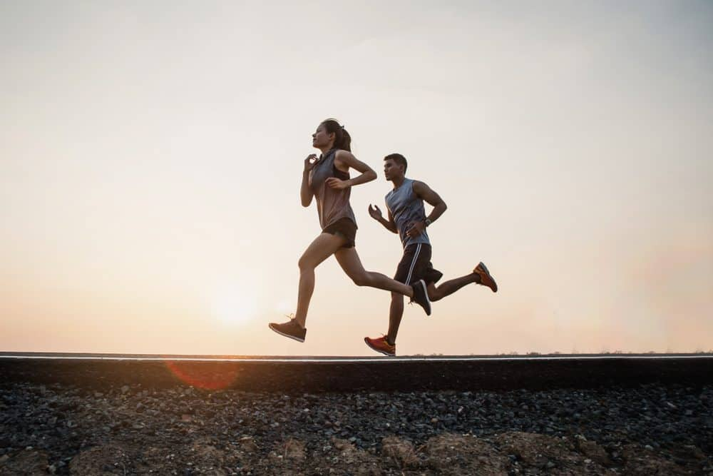 Young couple Exercise Running running on the street - How Frequently Should a Beginner Exercise Running to Achieve Best Results for the Body and Avoid Injuries Explained