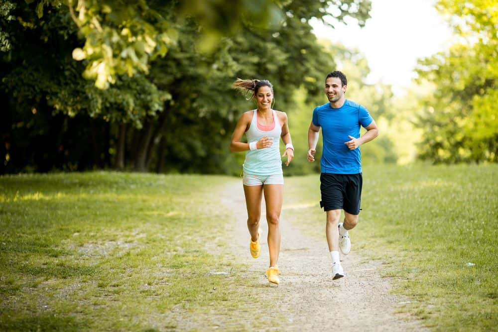 Young happy couple running - How Frequently Should a Beginner Exercise Running to Achieve Best Results for the Body and Avoid Injuries Explained