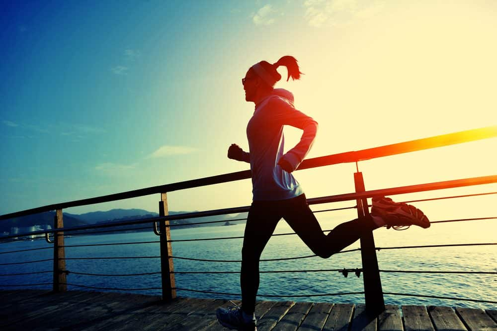 lifestyle sports woman running on wooden boardwalk - How to avoid the risks of Running as a beginner and boost your body
