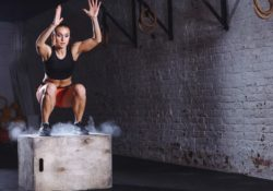 Young woman doing cross training - jumping box - How to Boost Your Body's Fitness Level and Avoid The Risk of Injury. The Ultimate Guide in Cross-Training.