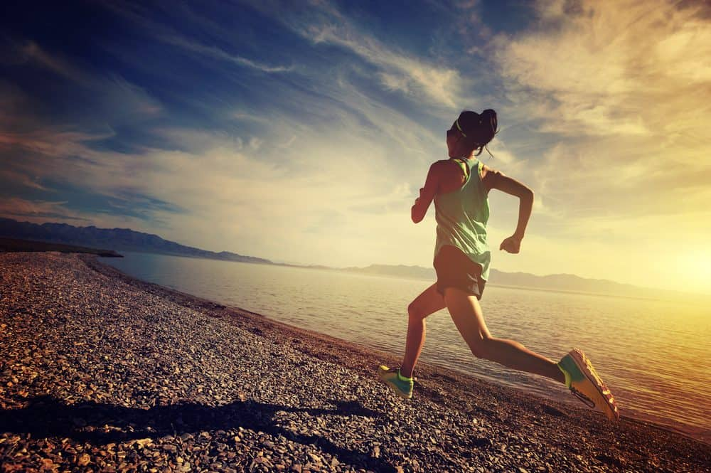 young woman running on seaside - How to avoid the risks of Running as a beginner and boost your body