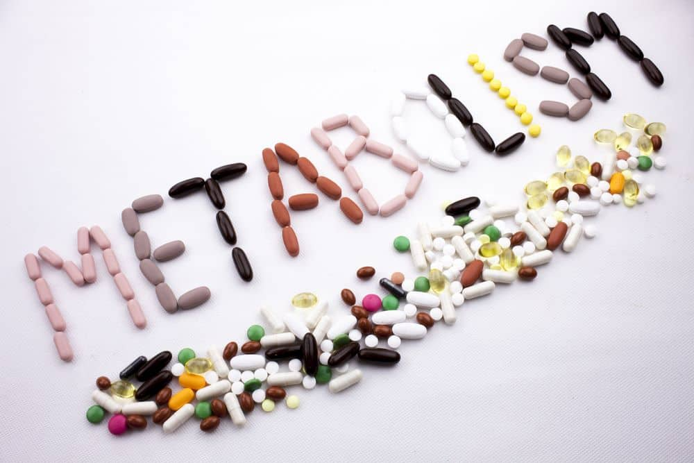 Health concept written with pills Metabolism