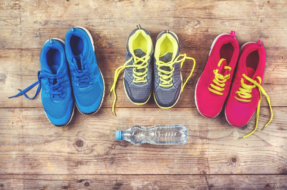 Various pairs of colorful running shoes - Running Gear for Beginners