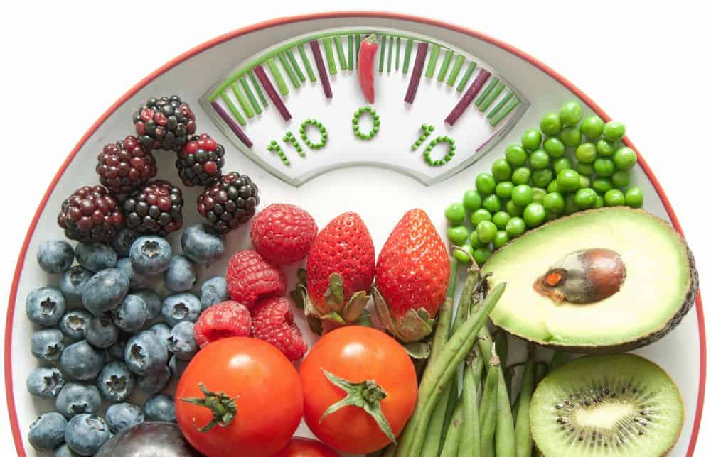 Weight Loss concept, bathroom scales made of food