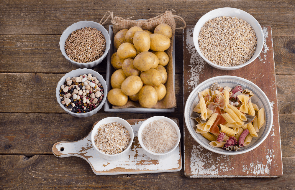 Healthy Food Best Sources of Carbs on a wooden background