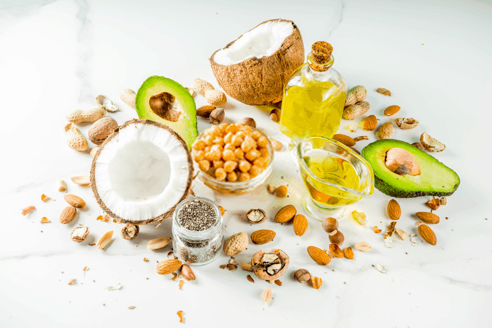 Healthy vegan fat food sources, omega3, omega6 ingredients - almond, pecan, hazelnuts, walnuts, olive oil, chia seeds, avocado, coconut