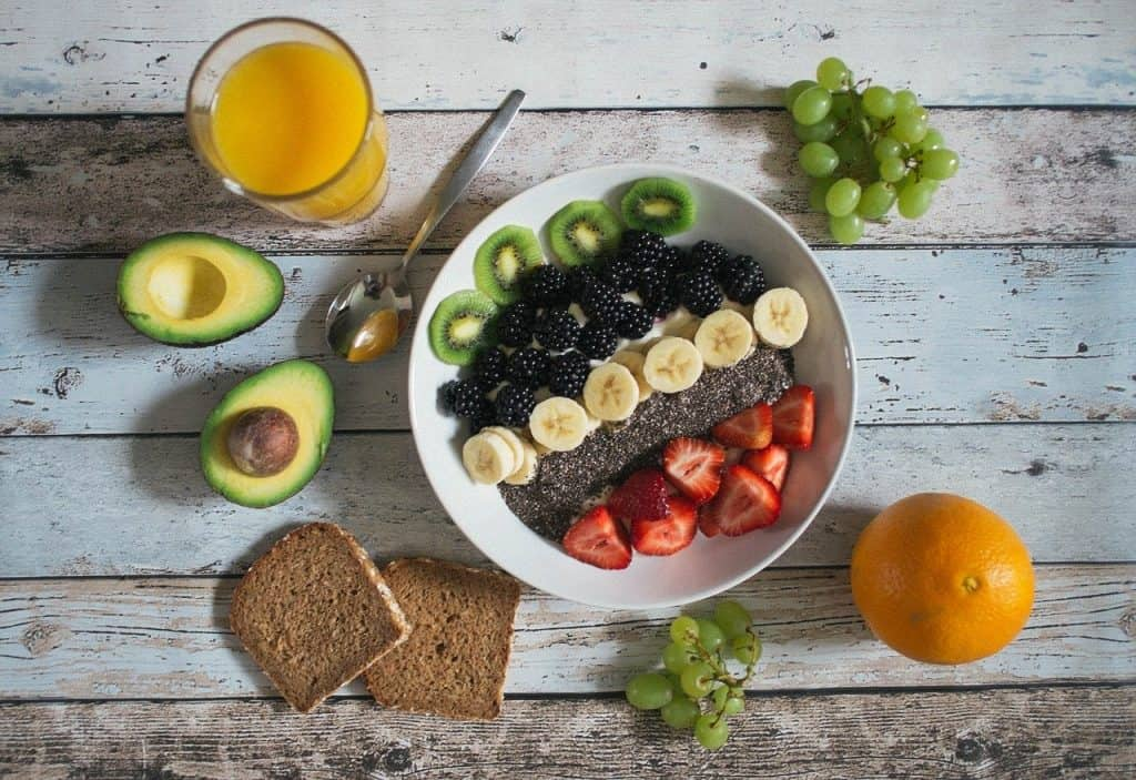 Bowl of fruit, toast, and glass of orange juice
