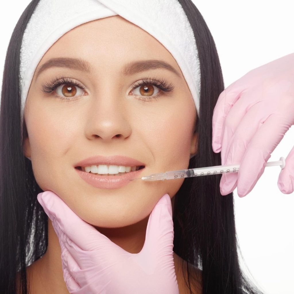A pretty girl is doing botox injections to reverse skin aging