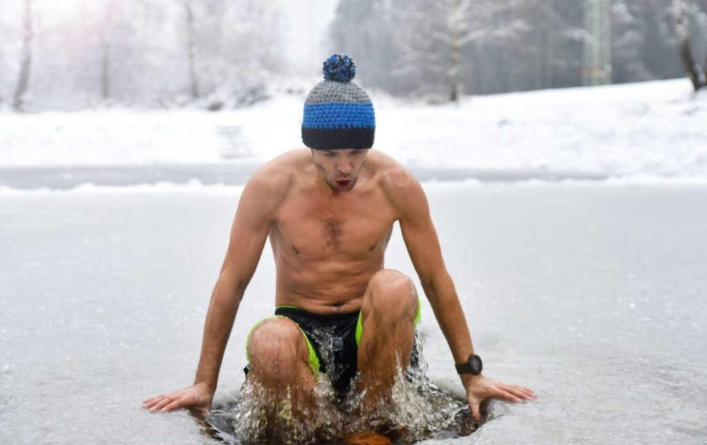 A man is taking a bath in freezing waters