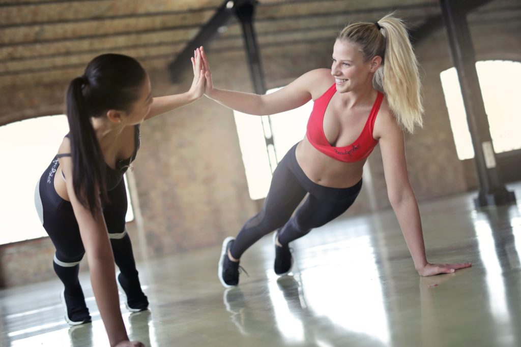 2 young women performing HIIT training