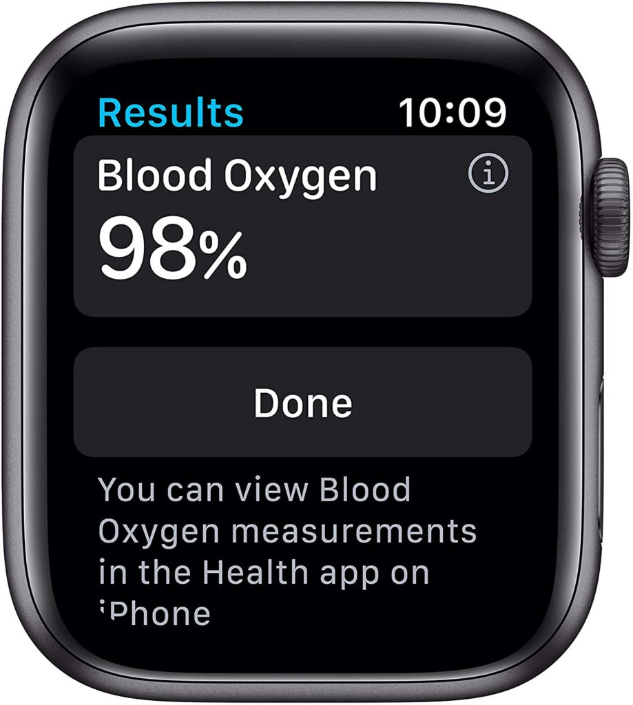 The Apple Watch Series 6 screen displays blood oxygen levels