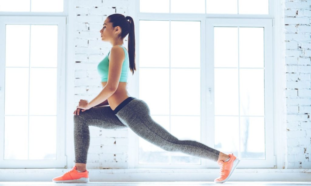 A girl is doing a warm up session in order to Stay Active During Coronavirus - Health and Fitness Tips